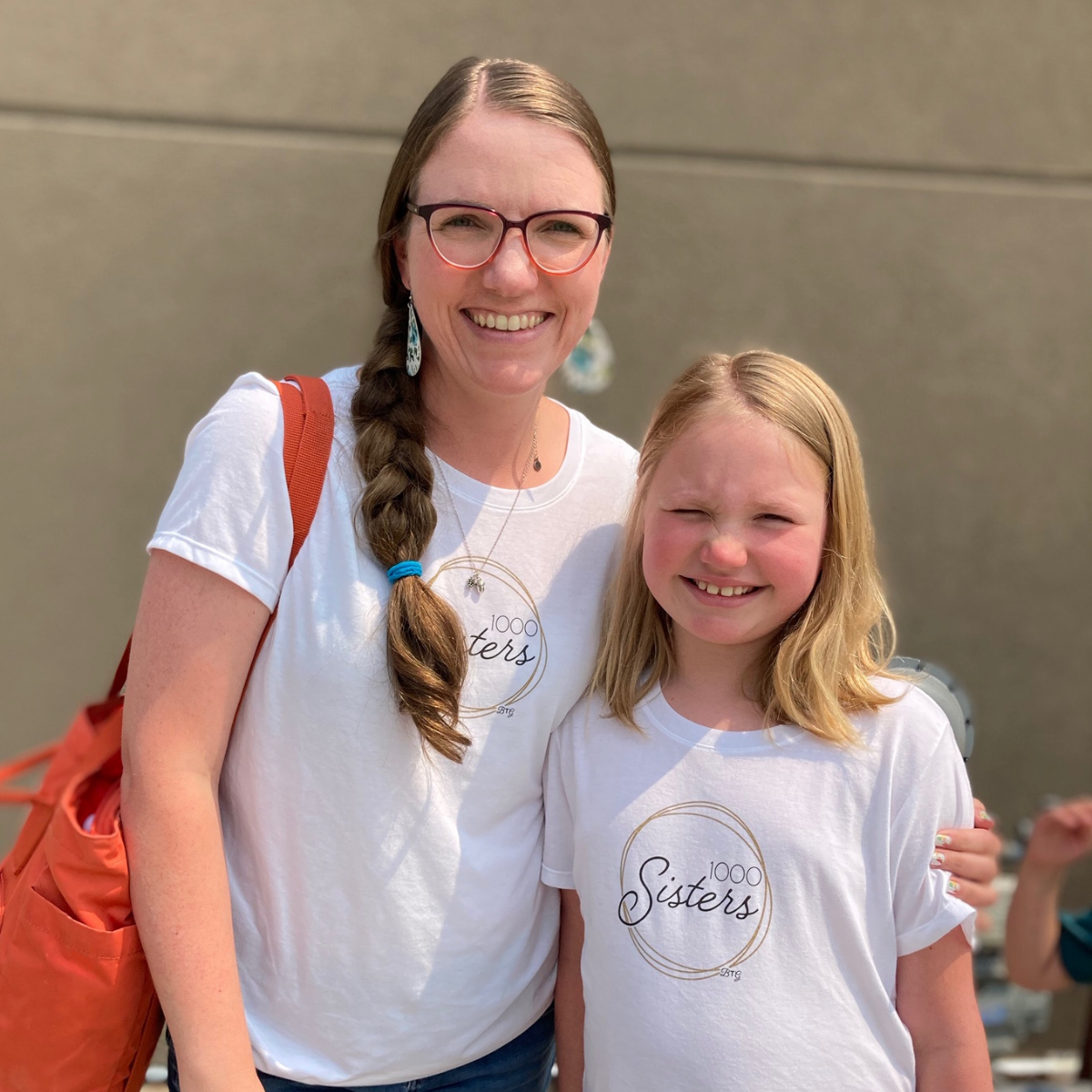 Ladies with 1,000 Sisters T-shirts